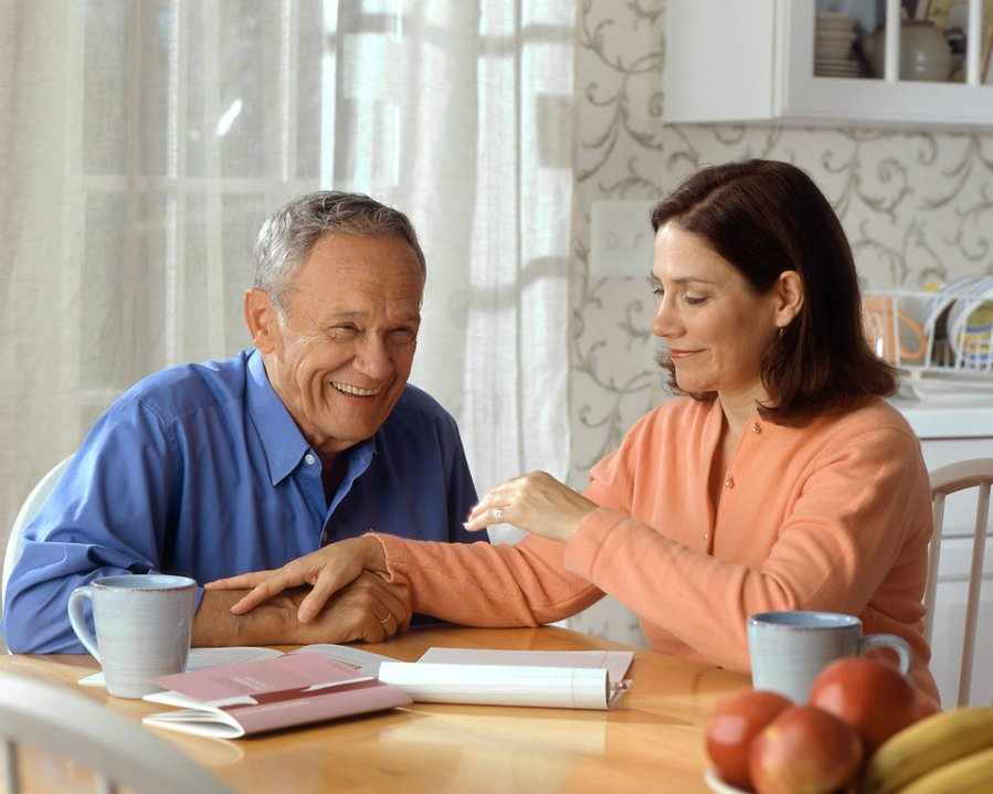 17069-a-woman-and-older-man-sitting-at-a-table-pv-free-stock-photos